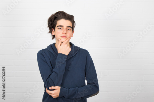 Fotografía  young thoughtful isolated on white background
