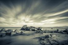 Sea Washing Over Rocks On Beac...