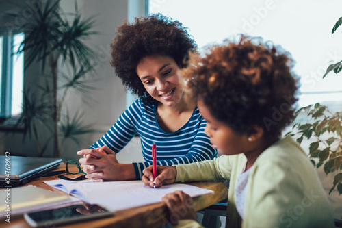 Tela Mother and daughter doing homework learning to calculate