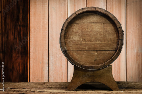 Foto auf AluDibond Schiff Wooden barrel and worn old table of wood.