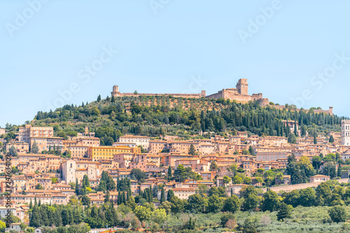 Town or village city of Assisi in Umbria, Italy cityscape of church during sunny summer day farm rural landscape Etruscan countryside hdr