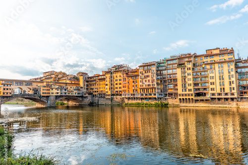 Photo Florence, Italy Firenze orange yellow colorful buildings and Arno river during s