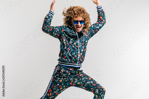 Excited adult funny man in stylish vintage clothes posing on white studio background Fotobehang