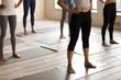 Legs of toned yogi standing prepared for yoga session