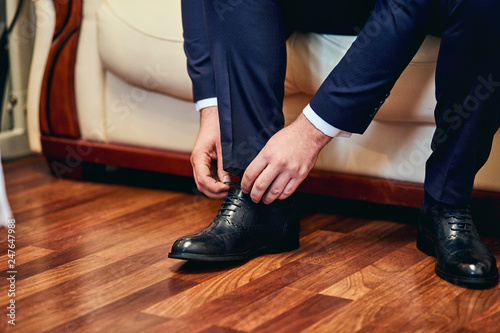 Valokuva  businessman clothes shoes, man getting ready for work,groom morning before wedding ceremony