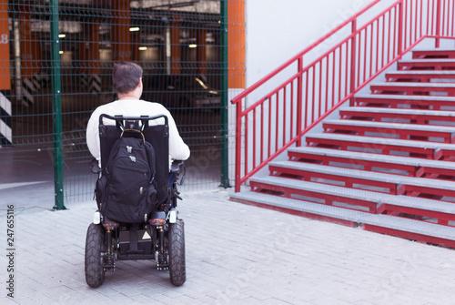 Fotografie, Obraz  a man in a wheelchair near the stairs