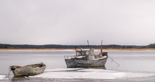 A Moored Fishing Boat In A Fro...