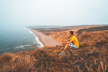 Hiker Exploring Point Reyes Cliffs In California.