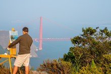 Young Man Painting A Golden Gate  Masterpiece In San Francisco, USA. Nature Art.