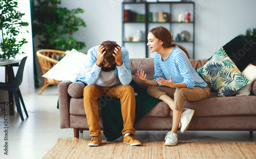 Photo family couple quarrels in a conflict at home