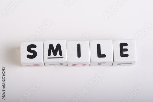 Fotografia, Obraz  tiles smile word