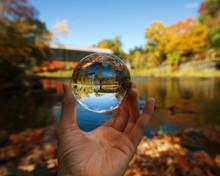 Crystal Ball Showing Reflection Of Covered Bridge During Autumn