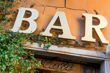 Bar And Cafe Sign On Local Restaurant In Trastevere, Bohemian Part Of Rome, Italy