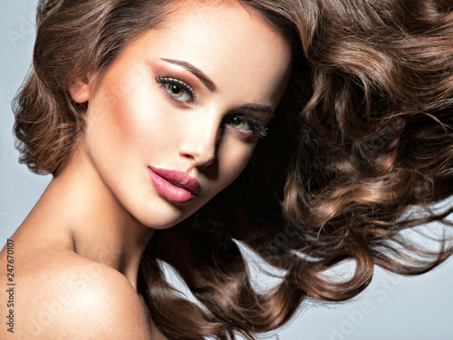 фотография  Face of a beautiful  woman with long flying   hair