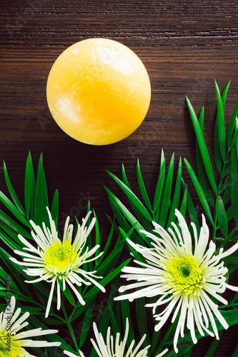 Yellow Aventurine Sphere with White Chrysanthemums and Foliage