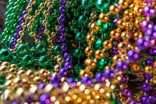 Canvas-taulu mardi gras beads with bokeh in green, gold, and purple