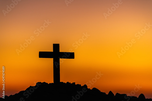 The silhouette of the cross across the mountain at sunset Wallpaper Mural