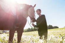 Young Man Riding A Horse In The Field