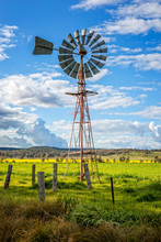 Southern Cross Windmill In A Rural Field With Crops