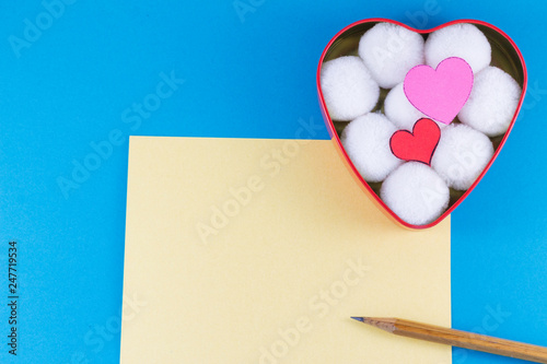 Fotografie, Obraz  A blank yellow letter with a wooden pencil and a heart-shaped box with cotton ba