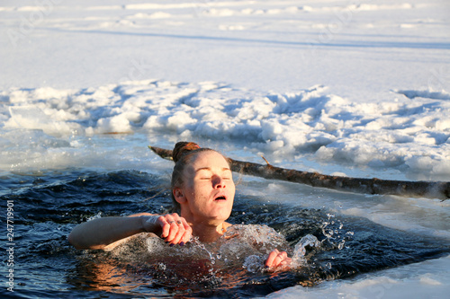 Young woman crosses herself plunging into icy water during Ukraine Canvas Print
