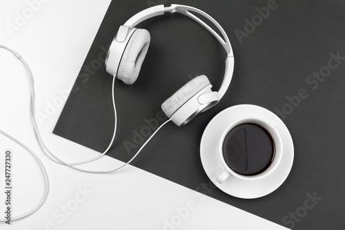 Fototapeta Black and white composition with stylish headphones, flat lay obraz na płótnie