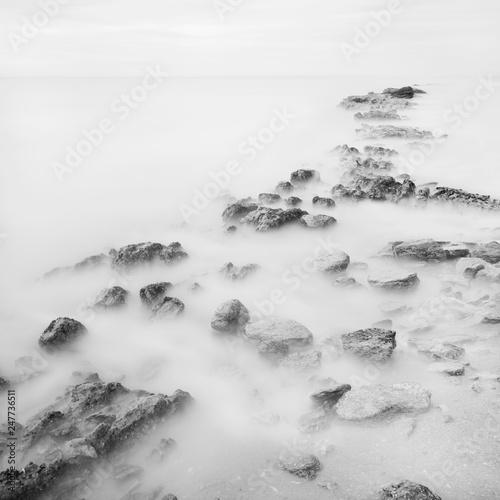 Photographie  Black White Long exposure artistic landscape, sea and stones