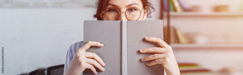 Fototapety, obrazy: woman in glasses covering face with book