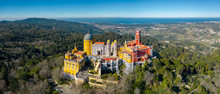 Aerial View Of Pena Palace, Castle Stands On Sintra Mountains; Monument And One Of The Seven Wonders Of Portugal, Mixture Of Eclectic Styles Includes The Neo-Gothic, Manueline, Islamic, Renaissance
