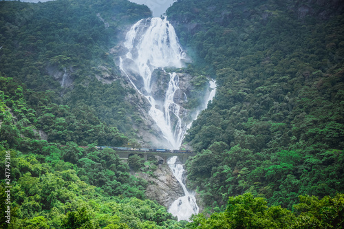 Foto auf AluDibond Wasserfalle The huge waterfall Dudhsagar and the railway bridge passing through it. Karnataka, India