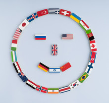 Illustration Of A Smiley Face From National Flags On Dominoes. Concept Of Peace And The Commonwealth Of Nations And The World Order
