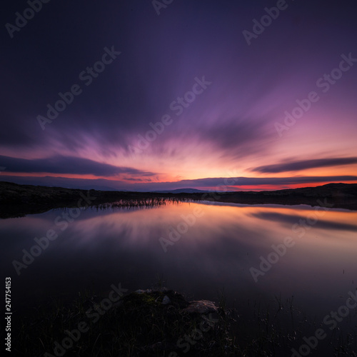 Long exposure on night sky and small lake in area of Nordgruvefeltet in middle Norway Fototapeta