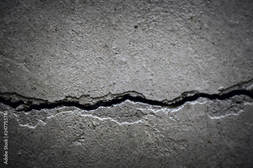 Fototapeta texture crack in concrete wall close-up