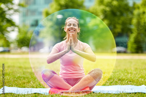 Tablou Canvas fitness, yoga and healthy lifestyle concept - happy woman meditating in summer p
