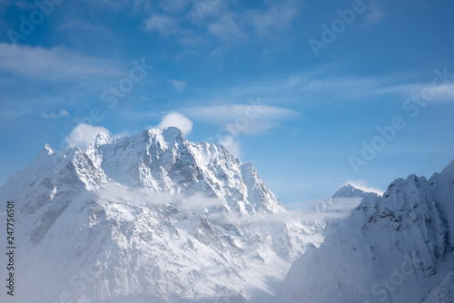 Foto auf Gartenposter Gebirge snowy mountain peaks in winter day with blue sky in Dombay, Caucasus, Karachay-Cherkessia, Russia
