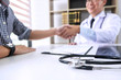 Professor Doctor having shaking hands with patient after recommend treatment method while discussing explaining his symptoms or counsel diagnosis health, healthcare and assistance concept