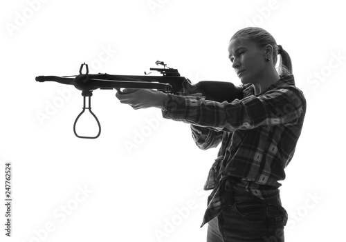 Foto Portrait of beautiful woman with crossbow on white background