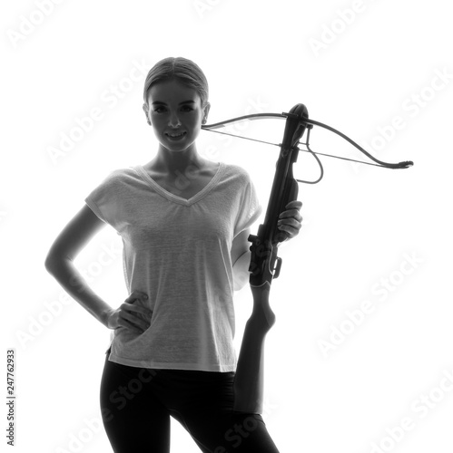 Photographie Portrait of beautiful woman with crossbow on white background
