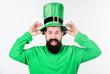 Leinwanddruck Bild - Global celebration of irish culture. Saint patricks day holiday. Green color part of celebration. Myth of leprechaun. Happy patricks day. Man bearded hipster wear green clothing and hat patricks day