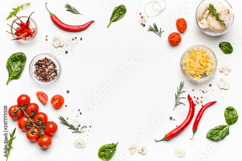 Fotografering Colorful pizza ingredients on white background, top view
