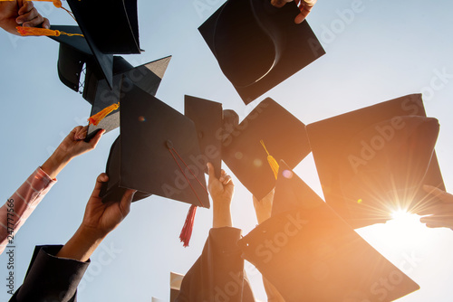 Stampa su Tela Black hat of the graduates floating in the sky.