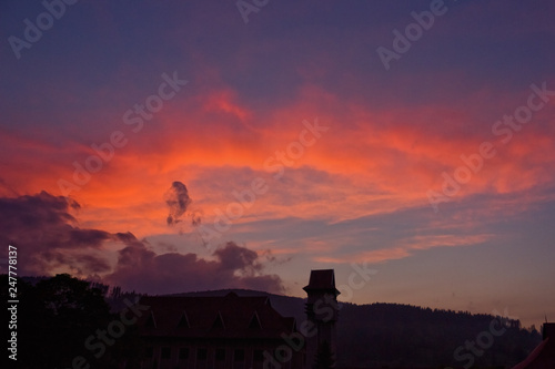 Foto op Aluminium Aubergine Colorful sunset over mountains and forest