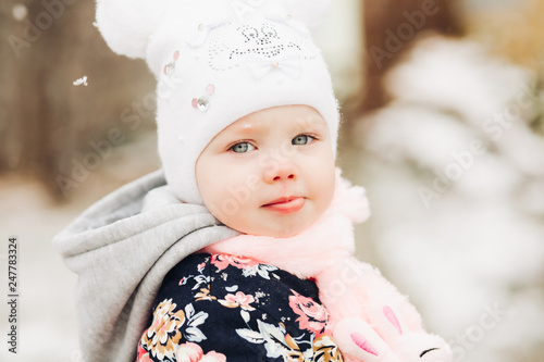 a57b7c0f3 Portrait of baby girl with blue eyes turned at camera. Kid playing ...