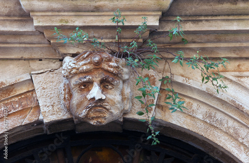 Fototapeta  Stucco mask on the facade