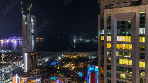 Fototapety, obrazy: Aerial view of modern skyscrapers and beach at Jumeirah Beach Residence JBR night timelapse in Dubai, UAE