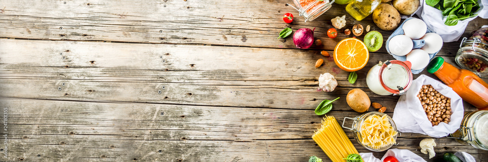 Fototapety, obrazy: Zero waste shopping and sustanable lifestyle concept, various farm organic vegetables, grains, pasta, eggs and fruits in reusable packaging supermarket bags. copy space top view, banner