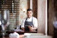 Portrait Of Male Chef With Dig...