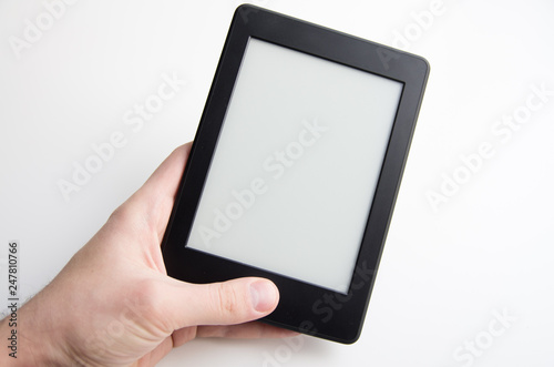 Canvas-taulu Hand holding blank ebook with blank screen