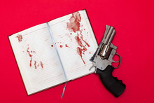 Revolver And Notebook