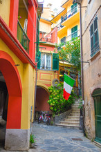 Typical Small Italian Yard With Buildings Houses, Stairs, Shutter Window And Italian Flag In Monterosso Village, National Park Cinque Terre, La Spezia Province, Liguria, Italy
